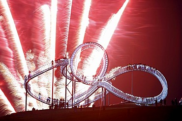 "Fireworks display during opening of the walkable landmark sculpture in the shape of a roller coaster, ""Tiger & Turtle ? Magic Mountain"" by Heike Mutter and Ulrich Genth, Angerpark on Heinrich-Hildebrand-Hoehe, mining waste tip, Duisburg, North Rhine-Westp"