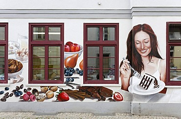 Woman eating cake, mural painting on a confectionery, Erfurt, Thuringia, Germany, Europe, PublicGround