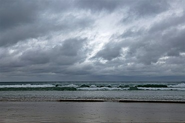 Surfers waiting for waves during stormy weather on the coast of Newquay, Cornwall, England, United Kingdom, Europe