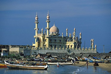 Fishing boats and mosque near Kovalam, Kerala, South India, India, Asia