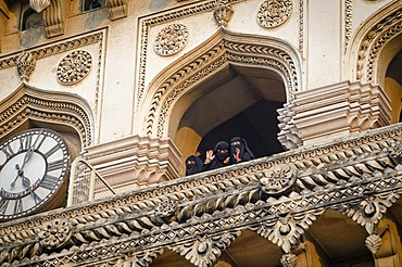 Muslim women waving down from the Charminar monument, Hyderabad, Andhra Pradesh, India, Asia