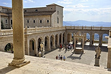 Cloister of Bramante with cistern and statues of St. Benedict and St. Scholastica, Benedictine abbey of Montecassino, Monte Cassino, Cassino, Lazio, Italy, Europe