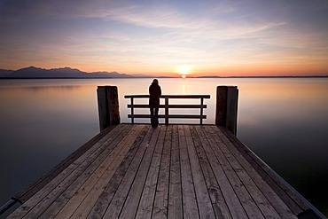 Woman on a dock in the evening light near Chieming on Lake Chiemsee, Bavaria, Germany, Europe, PublicGround