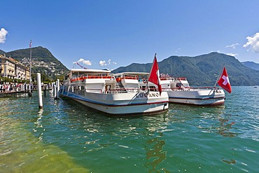 Excursion boats at the dock in Lugano, Lake Lugano, Lago di Lugano, Ticino, Switzerland, Europe