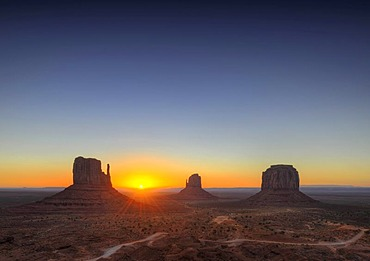 Sunrise, West Mitten Butte, East Mitten Butte and Merrick Butte table mountains and Scenic Drive, Monument Valley, Navajo Tribal Park, Navajo Nation Reservation, Arizona, Utah, United States of America