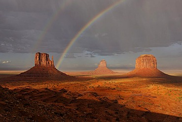 Double rainbow and rain in the evening light after a thunderstorm, West Mitten Butte, East Mitten Butte and Merrick Butte table mountains, Monument Valley, Navajo Tribal Park, Navajo Nation Reservation, Arizona, Utah, United States of America
