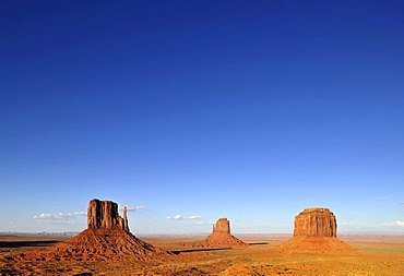 West Mitten Butte, East Mitten Butte and Merrick Butte table mountains and Scenic Drive in the evening light, Monument Valley, Navajo Tribal Park, Navajo Nation Reservation, Arizona, Utah, United States of America