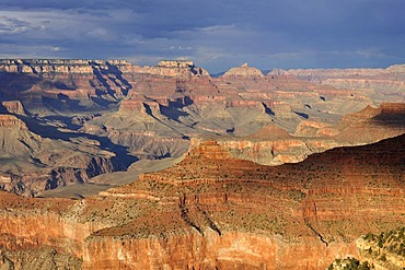 Thunderstorm brewing, view of Vishnu Temple Desert Palisades, Zoroaster Temple, Brahma Temple, Pattie's Butte at sunset from Yavapai Point, evening light, Grand Canyon National Park, South Rim, Arizona, United States of America, USA