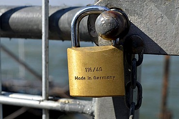 Padlock, Made in Germany, at a barrier fence along the Rhine Promenade, Duesseldorf, North Rhine-Westphalia, Germany, Europe