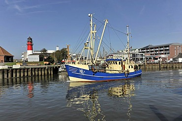 Shrimp cutter in the port of Buesum, with Buesum Lighthouse on the left, Schleswig-Holstein, Germany, Europe
