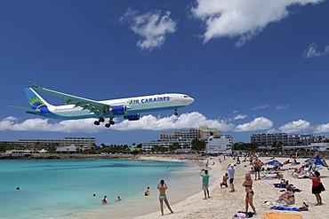 Air Caraibes aircraft landing over the beach of Saint Maarten, the island of Saint Maarten, Netherlands and France, Caribbean Sea