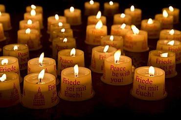 Candles as offerings for peace inside the Frauenkirche church, Dresden, Saxony, Germany, Europe