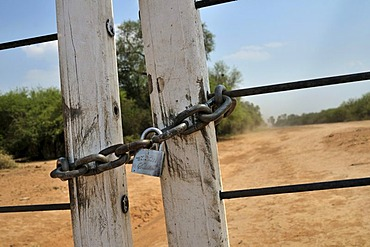 Locked gate, property owned by a big landowner, Gran Chaco region, Salta province, Argentina, South America