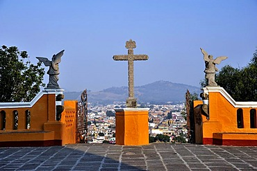Cross and angels with a view towards the city from the church of Iglesia Nuestra Senora de los Remedios, built on the pre-Hispanic Pyramid of Cholula, San Pedro Cholula, Puebla, Mexico, Latin America, North America
