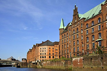 Speicherstadt, historic warehouse district, seen across the water from a harbour cruise in the Port of Hamburg, Hanseatic City of Hamburg, Germany, Europe