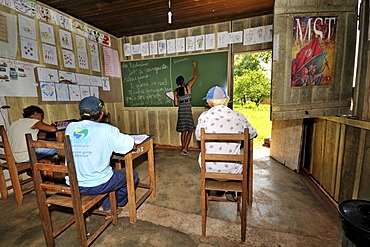 Adult education, adult men learning how to read and write in the village school of the Acampamento 12 de Otubro landless camp, Movimento dos Trabalhadores Rurais sem Terra, a Brazilian landless movement, MST, Munizip Claudia, Mato Grosso, Brazil, South Am