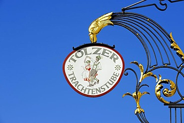 Hanging sign of Toelzer Trachtenstube, an inn on Marktstrasse, the market street of Bad Toelz, Upper Bavaria, Bavaria, Germany, Europe, PublicGround