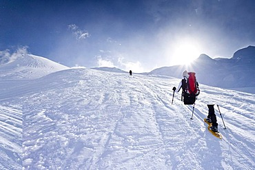 Snowshoe hiker climbing the Kleine Kreuzspitze Mountain in Racines above Sterzing, Alto Adige, Italy, Europe