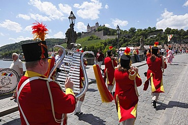 Parade in traditional costume during the Kiliani Festival, on Old Main bridge with Fortress Marienberg in the distance, Wuerzburg, Lower Franconia, Franconia, Bavaria, Germany, Europe, PublicGround