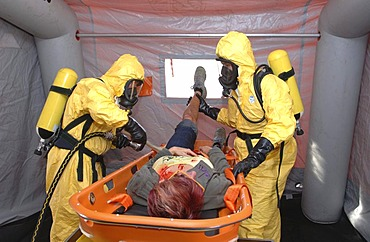 Firefighters wearing protective suits during the decontamination of an accident victim as part of a civil protection exercise on the A72 motorway near Chemnitz, Saxony, Germany, Europe