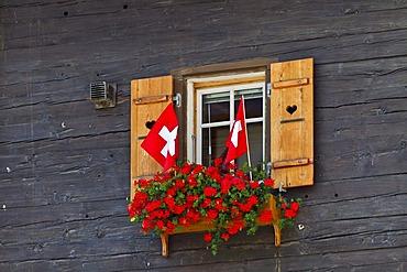Window with Swiss flags, Zermatt, Canton Valais, Switzerland, Europe