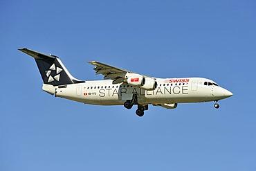Star Alliance BAE Systems Avro 146-RJ100 during the landing approach to Zurich Airport, Zurich, Switzerland, Europe
