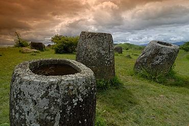 Archeology, ancient large stone jars in the landscape, Plain of Jars, Jar Site 1, Thong Hai Hin, near Phonsavan, province of Xieng Khouang, Laos, Southeast Asia, Asia
