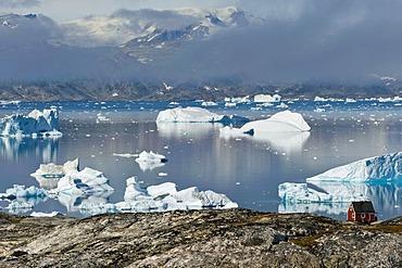 House, Inuit settlement of Tiniteqilaaq, icebergs in Sermilik Fjord, East Greenland, Greenland