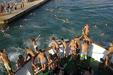 Children jumping from the prow of a ship into the sea, Borik, Zadar, Dalmatia, Adriatic, Croatia, Europe