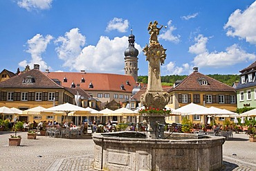 Rococo fountain on the market square in Weikersheim, looking towards the castle and a cafe, Baden-Wuerttemberg, Germany, Europe