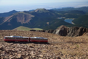 The Manitou and Pikes Peak Railway near the summit of Pikes Peak; the cog railway takes tourists to the top of the 14, 100-foot mountain, Colorado Springs, Colorado, USA