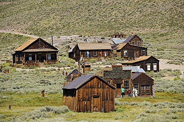 Tourists in the ghost town of Bodie, a former gold mining town, Bodie State Historic Park, California, United States of America, USA