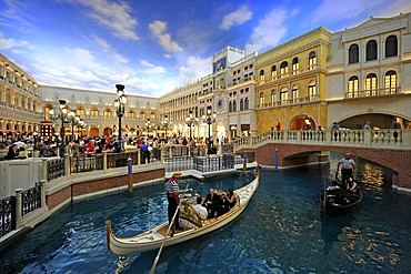 Tourists on a recreated Piazza San Marco, St. Mark's Square, under an artificial sky, Venetian alleys, a wedding ceremony in a wedding gondola, 5-star luxury hotel, The Venetian Casino, Las Vegas, Nevada, United States of America, USA