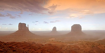 Sand storm before a thunderstorm in the evening light, mesas, West Mitten Butte, East Mitten Butte, Merrick Butte, Scenic Drive, Monument Valley, Navajo Tribal Park, Navajo Nation Reservation, Arizona, Utah, United States of America, USA