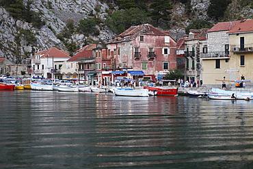 Boats in the harbor, coastal town of Omis, Croatia, Europe