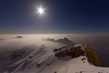 Night shot, Alpstein mountain rising out of the fog in full moon light, Saentis, Appenzell Outer-Rhodes, Appenzell Inner-Rhoden, Switzerland, Europe, PublicGround