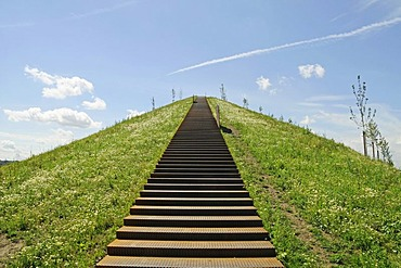 Steep stairs leading on a heap at Lake Phoenixsee on the grounds of the former steelworks Hermannshuette Phoenix-Ost, structural change, residential area, recreational area, Hoerde, Dortmund, North Rhine-Westphalia, Germany, Europe