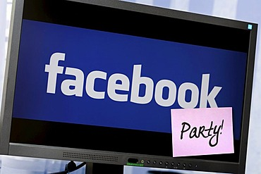 Computer with Facebook logo and sticker with the word party, symbolic image for Facebook parties