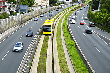 Autobahn A 40, motorway, Ruhrschnellweg with bus lanes, guided bus on the central reservation, noise barrier, Steele quarter, Essen, Ruhr Area, North Rhine-Westphalia, Germany, Europe