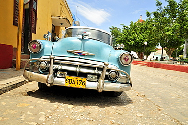 Chevrolet, classic car parked in the historic district of Trinidad, Cuba, Caribbean