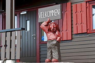 Troll figure holding a welcome sign, Hardangervidda mountain plateau, Norway, Scandinavia, Northern Europe