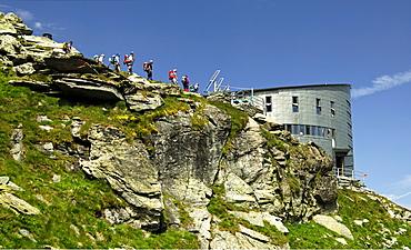 Group of hikers arriving at Velan Hut, Cabane du Velan, of the Swiss Alpine Club, SAC, Valais Alps, Valais, Switzerland, Europe