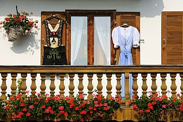 Farmhouse with lederhosen and a dirndl hanging on the shutters, Reichersbeuern, district of Bad Toelz - Wolfratshausen, Upper Bavaria, Bavaria, Germany, Europe, PublicGround
