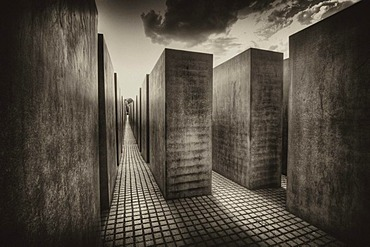 Black and white image, sepia-toned, of the stelae of the Holocaust Memorial designed by architect Peter Eisenman, Memorial to the Murdered Jews of Europe, Tiergarten, Berlin, Germany, Europe