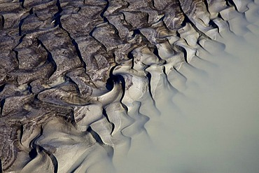 Sand structures on stream from the Vatnajoekull glacier, in Joekulheimar, south Iceland, Europe