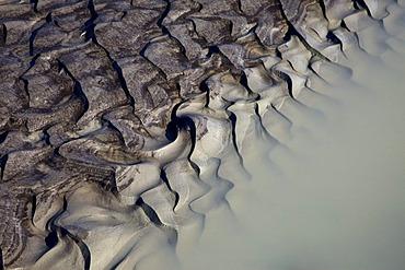 Sand structures on stream from the Vatnajoekull glacier, in Joekulheimar, south Iceland, Europe