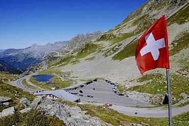Swiss flag, pass on the Sustenpass, 2224m, connecting Canton Bern with Uri, Switzerland, Europe