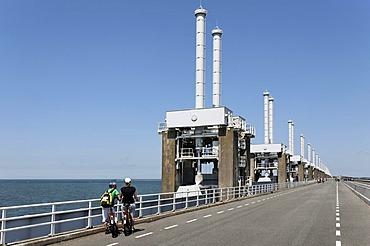 Storm surge barrier between Oosterschelde, Eastern Scheldt, and North Sea, cycling road, Zeeland, Netherlands, Europe