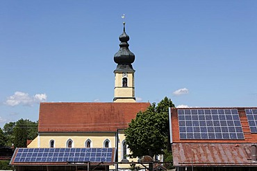 Church of the Nativity behind barnroofs with solar panels, Frauenried, Irschenberg district, Upper Bavaria, Bavaria, Germany, Europe