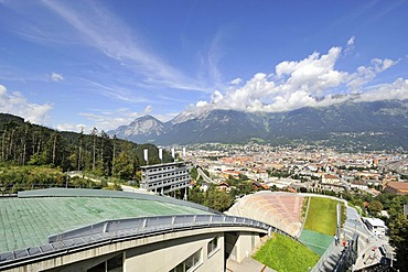 View from Bergisel Schanze ski-jump down onto the stadium, city of Innsbruck and Nordkette or Inntalkette mountain range at the back, Tyrol, Austria, Europe